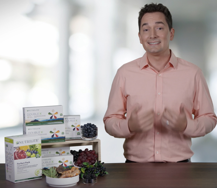 Nutrilite product expert at a table with Nutrilite Double X products.