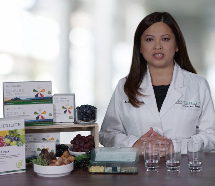 Nutrilite scientist at a table with Nutrilite Double X products.