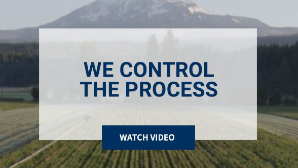 We Control the Process. Watch Video. Background image shows Nutrilite Farm.