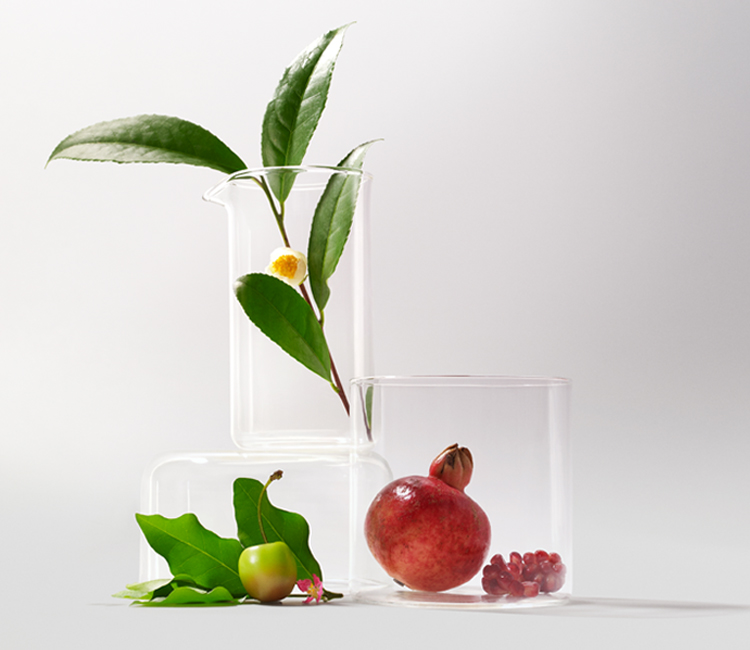 Nutrilite ingredients in glass vases.