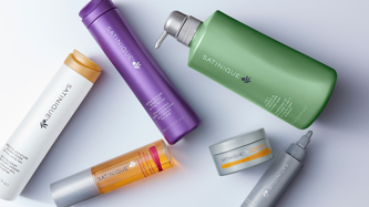 Complete your routine with our personal care lines. Background image showing Satinique personal care products.