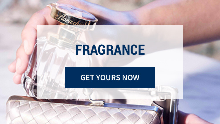 Fragrance: Let your beauty enchant. Enliven your senses with an alluring bouquet. Get yours now. Background image shows a close up of a woman's hands holding a fragrance bottle.