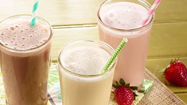 Discover your personalized eating plan. Background image shows three flavors of BodyKey shakes in tall glasses with colorful straws.