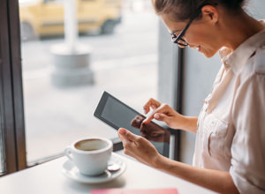 Supplement Guide: Find the right supplements in 3 easy steps. Background image shows woman using a tablet computer while sitting, drinking coffee.